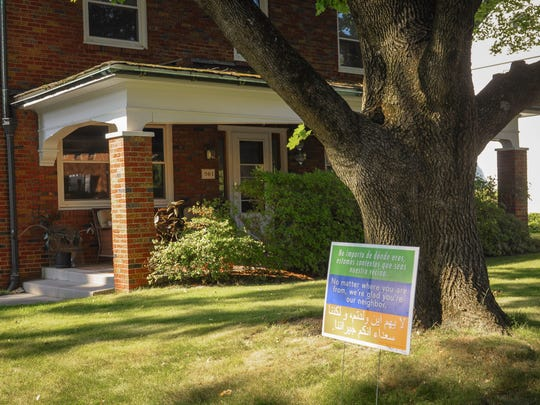 A sign welcomes refugees outside Craig Coble's house