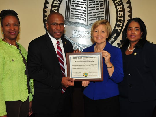 From left, Dr. Marsha Horton, dean of the College of Education, Health and Public Policy; DSU President Harry L. Williams; Marianne Carter, director of the Del. Center for Health Promotions; Dr. Michelle Fisher, director of DSU Health Service, display the national award DSU received for its no smoking policy on campus.