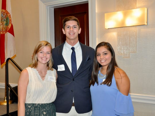 Michael Davis, center, stands with other Greater Estero Chamber of Commerce scholarship recipients at the annual chamber luncheon held in May at the Coconut Point Hyatt Regency Resort & Spa.