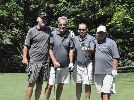 Ralph Dunnigan of Paxton's with his team of Matt Howard,