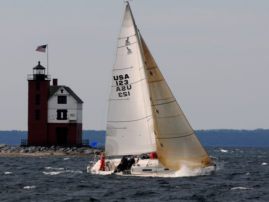 Port Huron Yacht Club's Good Lookin' crosses the finish line during the Port Huron-to-Mackinac Island Sailboat Race.