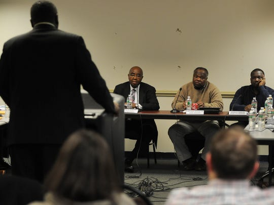 Jonathan Hodges, the longest-serving member of the Paterson Board of Education, said he is frustrated with test scores. He's seen here with former Superintendent Donnie Evans, left, and board member Kenneth Simmons at a 2015 budget hearing.
