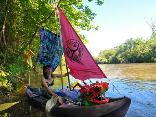 Julie Vann, of Asheville, prepares her boat for the Anything That Floats Parade on the French Broad River. Julie Vann of Asheville prepares her boat for the Anything That Floats Parade on Saturday, August 13, 2016 at Hominey reek Park in Asheville.