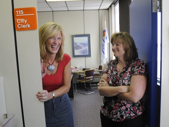 Port Huron Mayor Pauline Repp, when she was retiring as city clerk, and her then-successor Sue Child share a laugh on Friday, Aug. 1, 2008, in Port Huron Municipal Office Building. Child has more recently announced her own resignation.