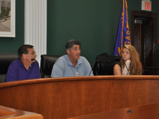 Mayor and Planning Board member Richard Rigoglioso (center) wants to revitalize the six-block area around the Passaic Street train station and change the city's image.