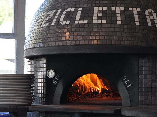 Pizzicletta's pizza oven was crafted in Italy and can