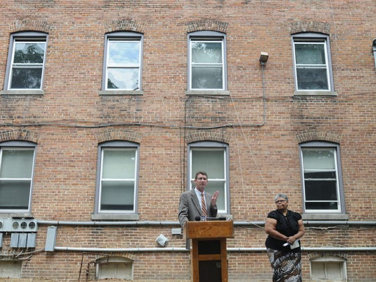 Then-mayor Jim Ireton, left, shows his outrage about how a City Council changed course on the city-owned apartment building known as The Bricks in 2011.