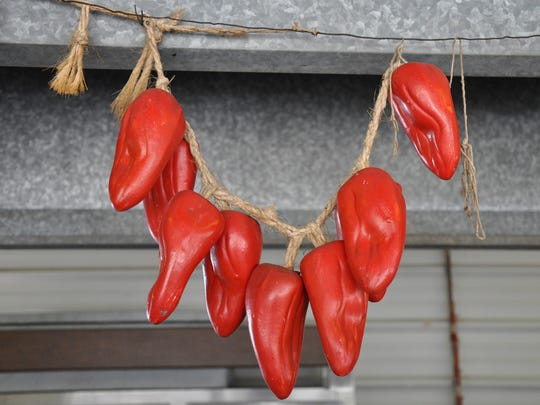 Decorative peppers hang in the Mi Ranchito food booth at Taylor County Expo Center on Monday, Sept. 4, 2017.
