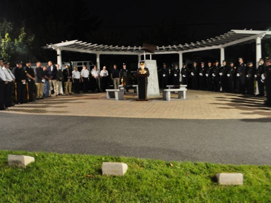 The somber Sept. 11 observance at Village Green Park in Carlstadt featured bagpipes and reflections on the lives lost.