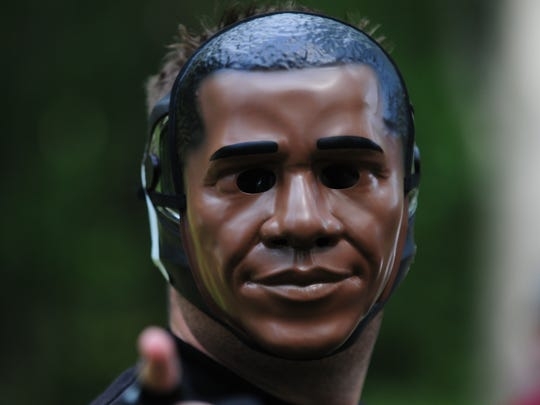 In this file photo, a paintball participant wears an Obama mask during an event at the Oasis Bar 'N' Grill in Whaleyville.