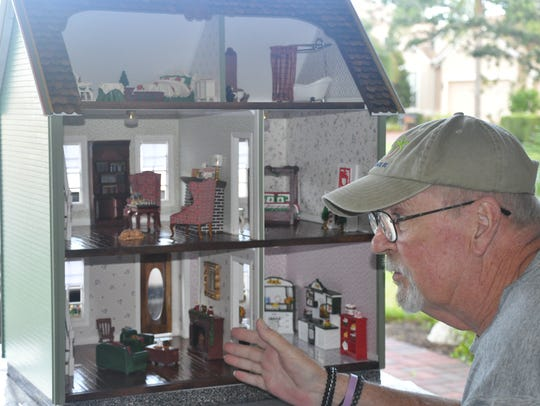 VNA volunteer Tom Shoaf with the restored dollhouse.