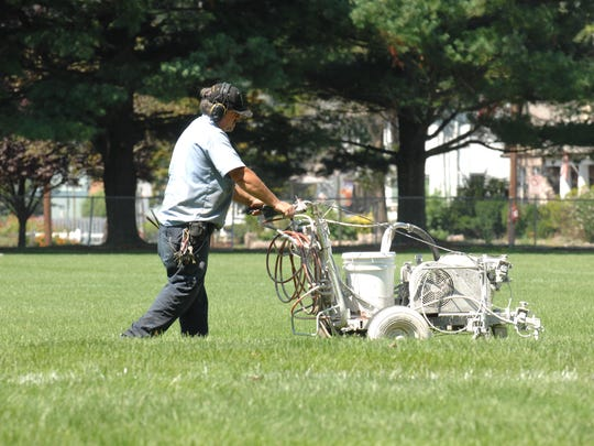 In Pompton Lakes Lakeside School Custodian Pete Jennings lining the soccer field in preparation for a girls' high school soccer practice in 2010.