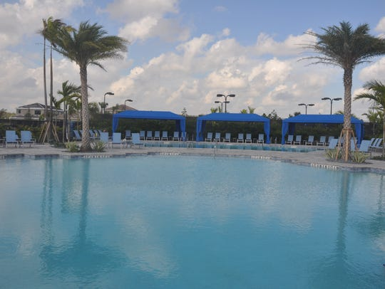The clubhouse and pool area has a variety of pools