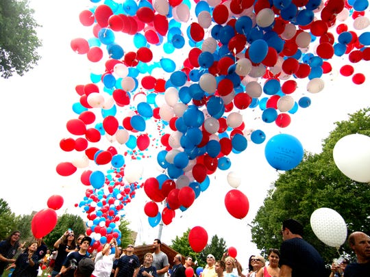 Balloons traditionally are released for a variety of reasons, including to celebrate achievements or observe important dates. Here, citizens of Lyndhurst mark the 10th anniversary of 9/11 with a patriotic launch.