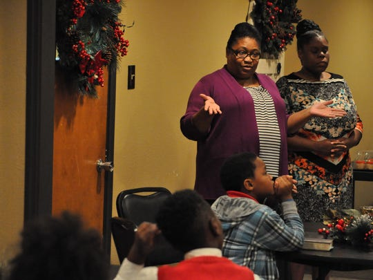 Rolanda Russell, wife of Rev. John Russell, talks to the youth of Calvary Tabernacle on Third Street in Alexandria.