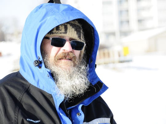 Gary Newell, of Lexington, was ice fishing Saturday, Dec. 30, 2017, at the Lexington Harbor.