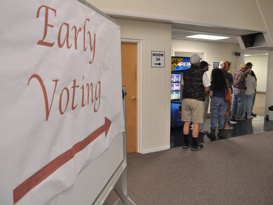 Voters line up in Marshall to cast ballots on the first day of early voting during the 2016 presidential election.