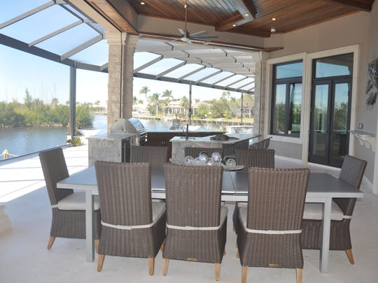 The home includes a more than 140-foot lanai along the water.