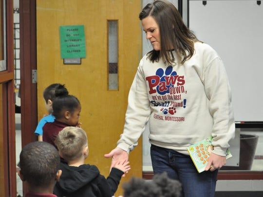 Principal Jennifer Koehler high fives a Rosenthal Elementary student.