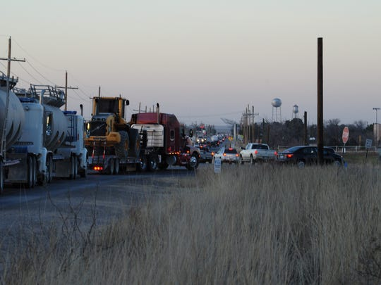 Traffic on U.S. Highway 285 Feb. 8 near Loving, New Mexico begins to roll slowly as miles of highway is lined with large commercial vehicles. In this photo, oilfield traffic from Higby Hole Road waits for an opportunity to turn onto the highway.