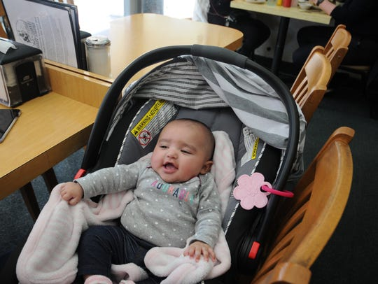 Margot Woodley, who is 4-months-old, gurgled happily all through her mother's lunch with her grandmother.