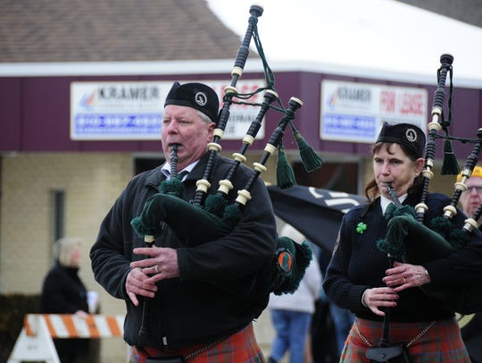 Members of the Michigan Scottish Pipes and Drums march