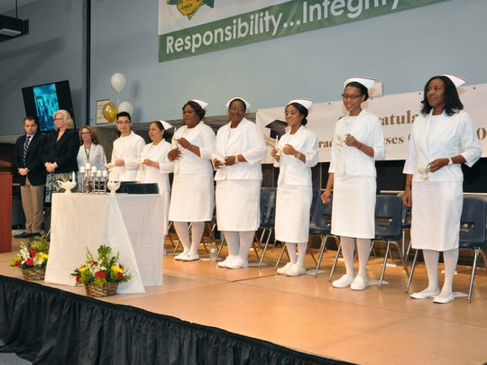The graduation for the MCVTS practical nursing program, held on the Piscataway campus, featured a candle-lighting ceremony.