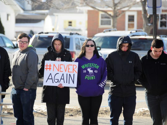 Port Huron High School students stand outside while participating in a nationwide walkout against gun violence in schools on March 14. Students will lead the March for Our Lives on Saturday, calling for gun control.