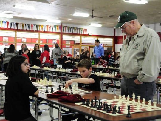 Lonnie Rutkofske checks out a match between Fiona Marlatt