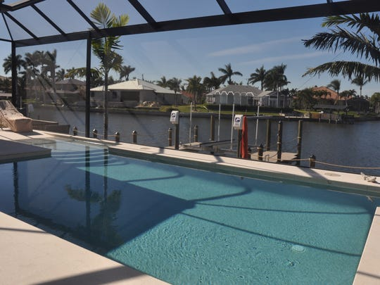 Picture screens keep the view of the canals in Cape Coral from being blocked.