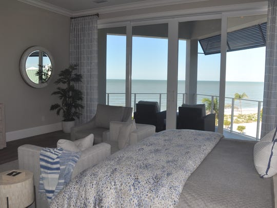 The master bedroom leads to a terrace with beach and