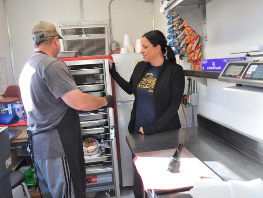 Diana Stearns usually works the window of Jay's BBQ Shack food trailer while her husband, Jay, cuts the meats and prepares the orders.