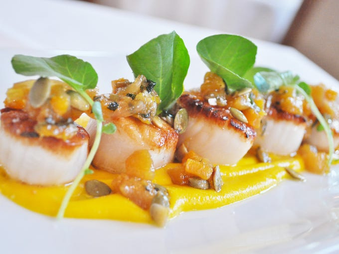 The scallops on Cafe Lurcat's new menu are seared,