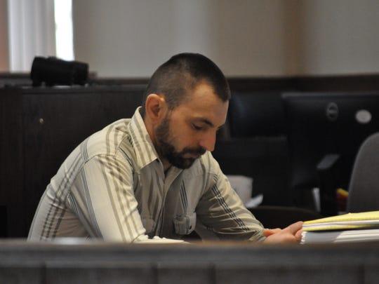 Thomas Enloe sits awaiting trial to resume on Wednesday,