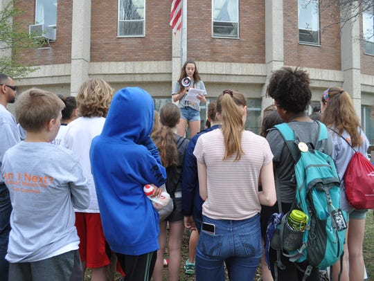 Shorewood Intermediate School student Ellie Sweet speaks to 40 of her classmates during a school walkout for gun reform on Wednesday, May 2.