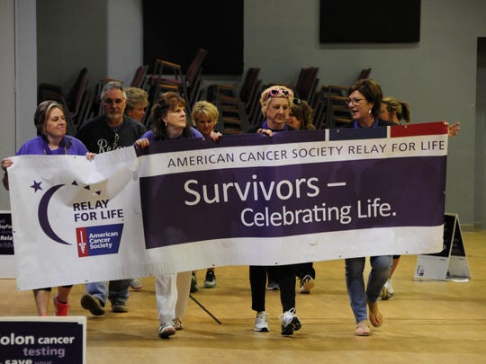 Coleen Gill, Nancy Wolff, Coreena Malburg and Deb Johnson lead the Relay for Life on Saturday, May 5, 2018.