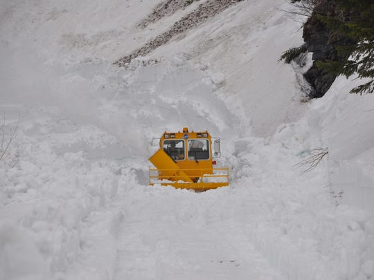 Plows work on the Going to the Sun Road In Glacier National Park