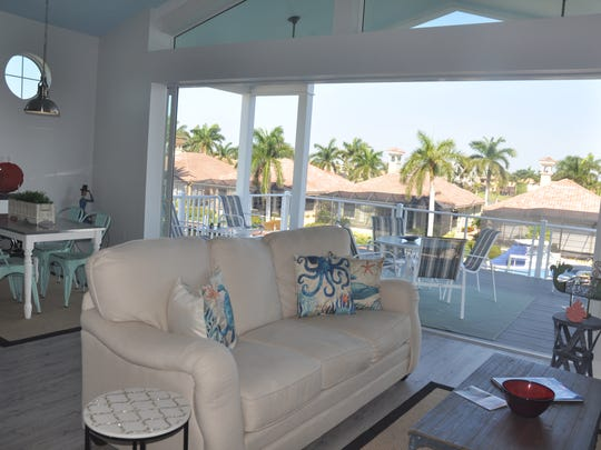 The Funky Fish House has a porch off the family room that hangs over the water.