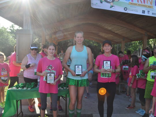 Top Overall Female Finishers were, from left, Girl