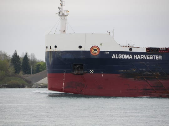The Algoma Harvester pushes a small bow wave while