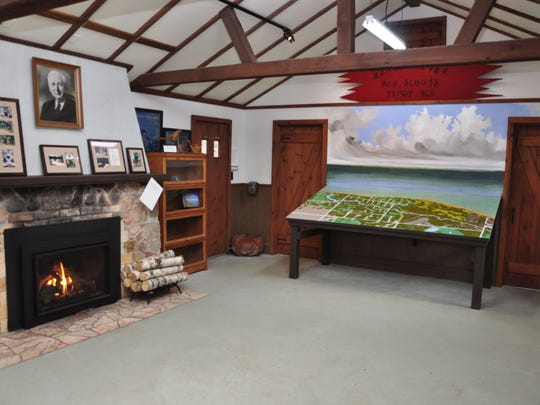 An interior view of the new facility showing the relief map of the area and photo of Alfred Jung over the fireplace.