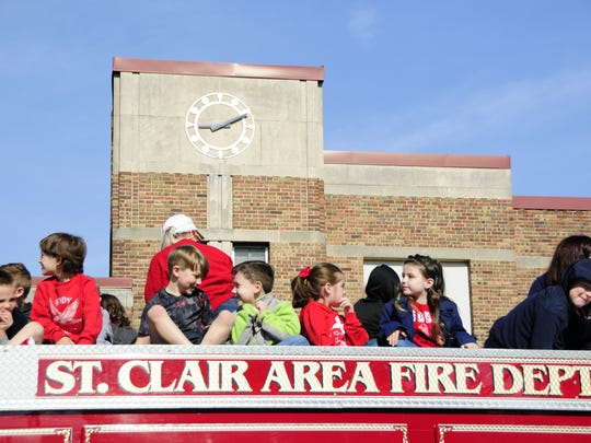 Kindergartners from Eddy Elementary in St. Clair prepare to ride a firetruck on Friday, May 18, 2018.