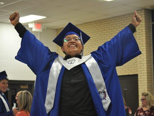 ECHS graduate Daisy Tapia celebrates commencement Thursday, May 17, 2018.