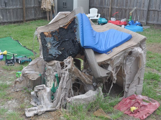A backyard toy set melted. Damien, 2, lost his toys in the fire. A May 9 fire destroyed the Buehl family home in Bonita Springs. Cindy Buehl said the family needs help.