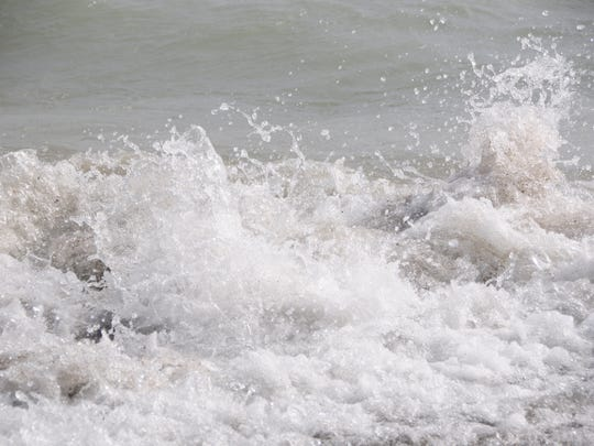 Spray erupts as a wave crashes onto the Lake Huron shoreline on Saturday, June 2, 2018. The National Weather Service in Detroit/Pontiac has issued a Beach Hazards Statement for dangerous swimming conditions through 8 p.m. on Lake Huron.