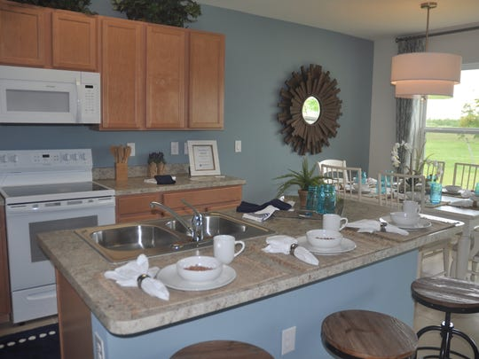 The Hamilton offers an island kitchen, walk-in closets