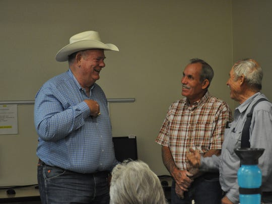 Ernie Carlson talks with city council member Mark Walterscheid and opponent James Walterscheid as they wait for primary results Tuesday, June 5, 2018, at the Eddy County Clerk's Office.