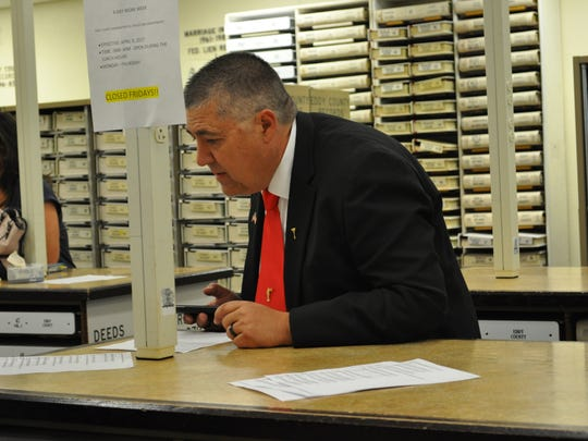Magistrate Judge Division 1 candidate Kelly Calicoat reviews primary election results Tuesday, June 5, 2018, at the Eddy County Clerk's Office. Calicoat, a Republican, won against Republican candidate Jim Smith.