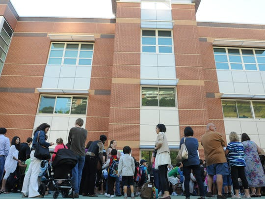 In this 2012 file photo, students line up for the first day of school at the George Washington School in Edgewater.
