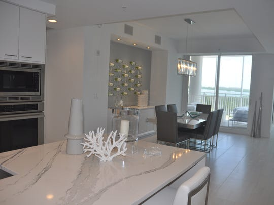 The sixth floor model is very contemporary and features a wine wall that shows like an art piece.